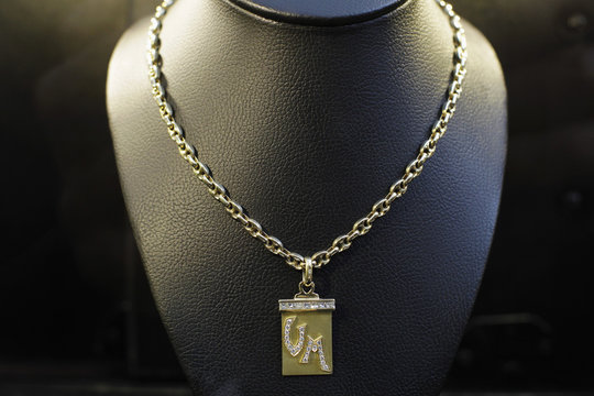 A gold medal with embedded diamonds, confiscated from Peru's former head of Intelligence Vladimiro Montesinos, is displayed to the media before auction, in Lima