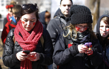 University and CEGEP students call members of the provincial Liberal government on their cell phone during a demonstration against a hike in tuition fees in Quebec City