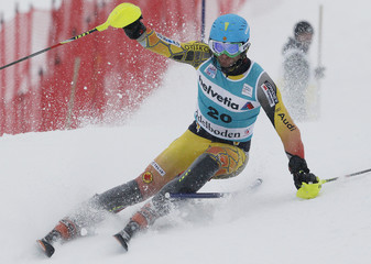 Janyk of Canada clears a gate during the first run of the men's alpine skiing World Cup slalom race in Adelboden