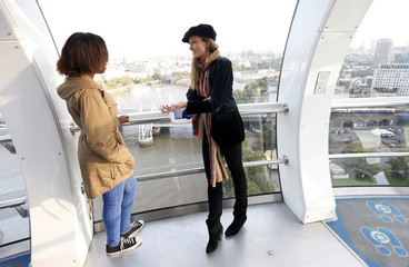 Actress Natascha McElhone talks with student Cheryl Adamson during a mentoring session held in the London Eye to mark the third UN International Day of the Girl in central London