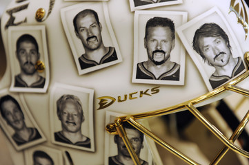 Pictures of the Anaheim Ducks' team with funny moustaches are seen on goalie Jonas Hiller's mask as part of a charity effort in Washington