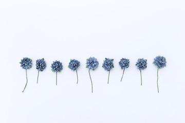 Blue paper flower on white background