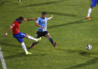 Chile's Isla shoots to score past Uruguay's Gonzalez during their quarter-finals Copa America 2015 soccer match at the National Stadium in Santiago