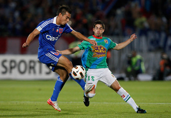 Universidad de Chile's Eduardo Vargas and Damian Perez of Argentina's Arsenal fight for the ball during their Copa Sudamericana soccer match in Santiago