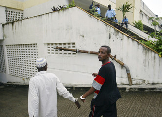 Suspected Somali pirates captured by British Navy in the Gulf of Aden arrive at court in the Kenyan port city of Mombasa
