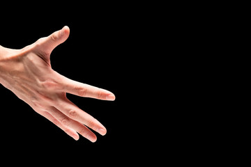 Male hand on a black background. Free space for text