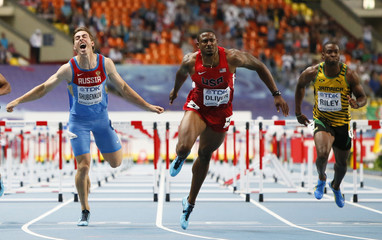 Oliver of the U.S. races to win ahead of Shubenkov of Russia and Riley of Jamaica in the men's 110 metres hurdles final during the IAAF World Athletics Championships at the Luzhniki Stadium in Moscow