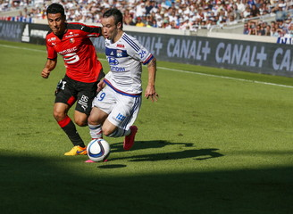 Olympique Lyon's Valbuena challenges Andre of Rennes during their French Ligue 1 soccer match at the Gerland stadium in Lyon