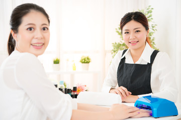 woman doing manicure and her manicurist