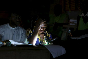An electoral observer listens to and writes vote counts at the end of the presidential and legislative elections, in the mostly muslim PK5 neighbourhood of Bangui