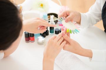 woman selects color shellac nail polish