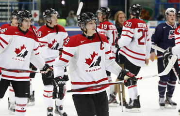 Canada's Nugent-Hopkins skates off the ice after his team was defeated by the U.S. in their semi-final game at the 2013 IIHF U20 World Junior Hockey Championship in Ufa