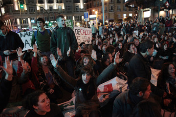 Demonstrators participate in a sit-in protest in Madrid