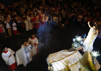 A priest offers incense during a procession to celebrate the Feast of the Resurrection on Easter Sunday in Manila