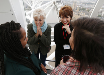 Actress Walters and Author Lette talk with Dunraven School students Chambers and Symonds during a mentoring session held in the London Eye to mark the third UN International Day of the Girl in central London
