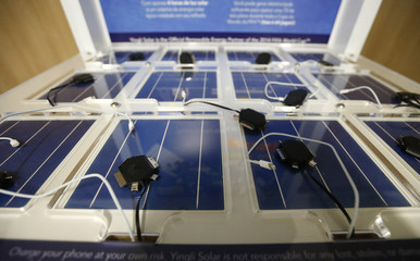 A solar powered re-charge station for mobile devices is seen at the media center of the Arena de Sao Paulo stadium in Sao Paulo