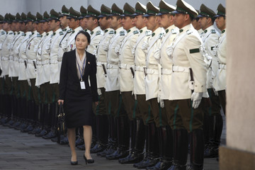 A member of South Korea's President Lee walks past an honour guard at the Presidential Palace at Santiago