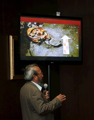 Barrera, an archaeologist from the National Institute of Anthropology and History, speaks to the media below a picture of a skull that was discovered at the ruins of the Templo Mayor Aztec complex, during a news conference in Mexico City