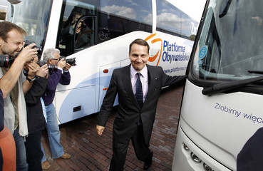 Sikorski, Poland's Minister of Foreign Affairs and member of Poland's ruling centre-right Civic Platform party (PO) walks in front of photographers in Warsaw