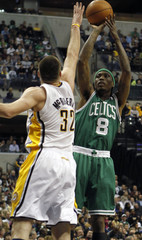 Celtics guard Daniels shoots the basketball defended by Pacers forward McRoberts during the first quarter of their NBA basketball game in Indianapolis
