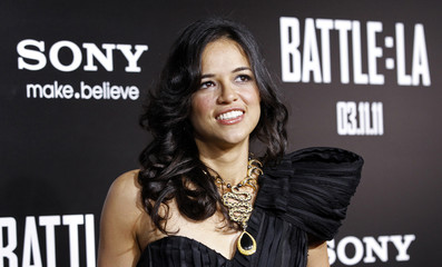 """Rodriguez poses at the premiere of """"Battle: Los Angeles"""" at the Regency Village theatre in Los Angeles"""