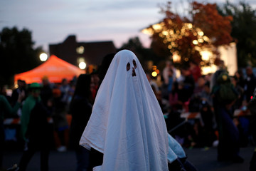 A man in a ghost costume marches in the annual Nyack Halloween Parade in the Village of Nyack