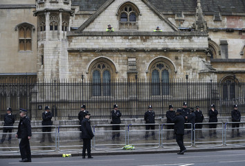 Police stand guard outside the Houses of Parliament for the funeral service of former British prime minister Margaret Thatcher at St Paul?s Cathedral, in London