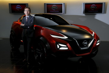 Nakamura, Senior Vice President and Chief Creative Officer of Nissan Motor Co, poses for a photo with Nissan Gripz concept car at the company's Global Design Center in Atsugi