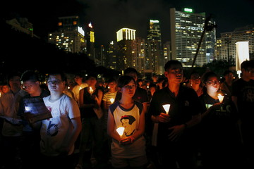 People attend an annual candlelight vigil at Victoria Park in Hong Kong