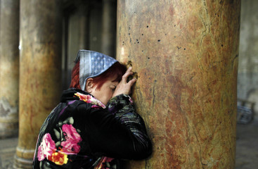 A worshipper prays in the Church of the Nativity in Bethlehem, ahead of Christmas