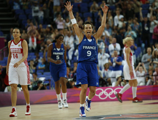 France's Dumerc celebrates victory against Russiaafter their women's basketball semifinal match at the North Greenwich Arena during the London 2012 Olympic Games