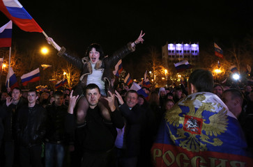 People celebrate the announcement of preliminary results of today's referendum in the Crimean city of Sevastopol