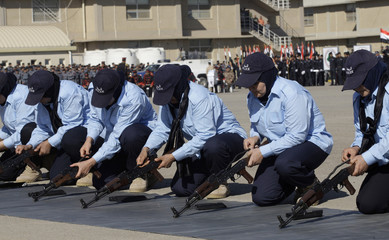 Female members of the Iraqi police demonstrate their weapon handling skills during celebrations marking Police Day in Baghdad