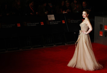 Actress Holliday Grainger arrives for the BAFTA awards ceremony at the Royal Opera House in London