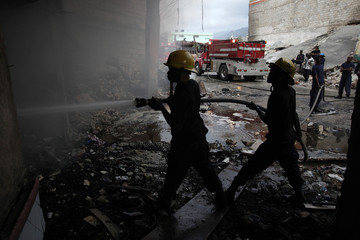 Haitian firefighters put out a fire at Port-au-Prince
