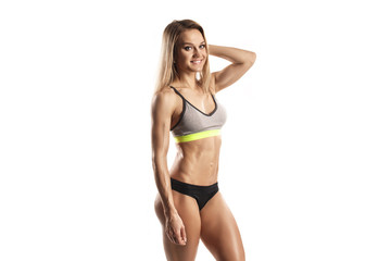 sexy young fitness girl posing isolated over white. Fitness woman in sport wear with perfect fitness body