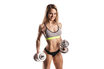 sexy young fitness girl doing workout with dumbbells isolated over white. Fitness woman in sport wear with perfect fitness body workout