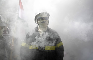 Firefighters attend a protest against the Hungarian government's austerity measures in Budapest