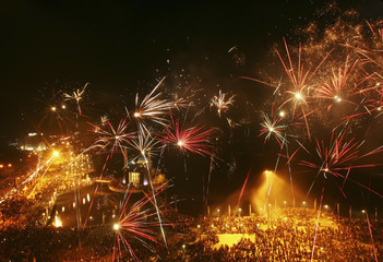 Fireworks explode above a floating mosque during New Year's Eve celebrations at Losari beach in Makassar