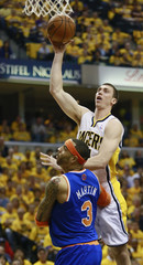 Indiana Pacers' Hansbrough shoots against New York Knicks' Martin during NBA Eastern Conference second round playoff basketball game in Indianapolis