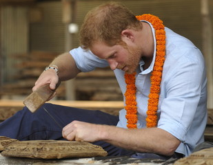 Britain's Prince Harry tries wood carving at a heritage site in Patan Durbar Square in the outskirts of Kathmandu