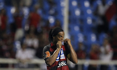 Brazil's Flamengo soccer player Ronaldinho celebrates after his debut for the club during a Carioca championship soccer match against Nova Iguacu in Rio de Janeiro