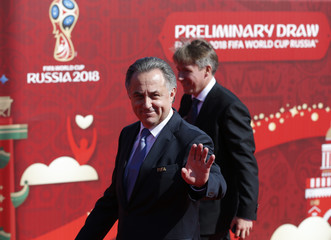 Russian Sports Minister Mutko waves as he arrives to the preliminary draw for the 2018 FIFA World Cup at Konstantin Palace in St. Petersburg