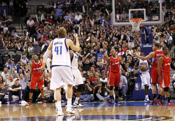 Dallas Mavericks forward Dirk Nowitzki reacts after hitting a shot against the Los Angeles Clippers during their NBA basketball game in Dallas, Texas