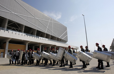 Ukrainian interior servicemen take part in a drill to prevent violence among hooligans before the Euro 2012 soccer championship, at the Arena Lviv stadium in Lviv