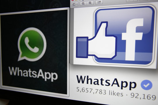 "Illustration photo shows ""likes"" on WhatsApp's Facebook page displayed on a laptop screen in Paris"
