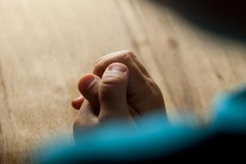 Child hands folded for prayer