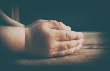 Child hands folded for prayer
