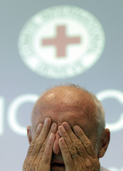 Kellenberger President of the International Committee of the Red Cross wipes his eyes before a news conference in Geneva