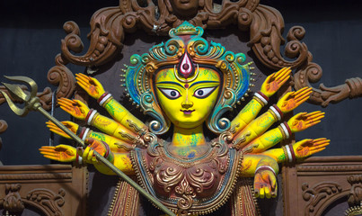 Durga idol in terracotta artistic style closeup portrait. Goddess durga is worshiped by Hindus in India and abroad and depicts victory of good over evil.